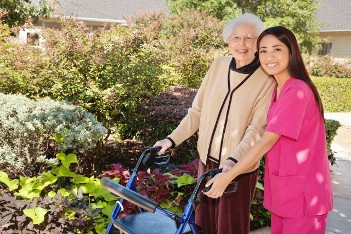 Elder Care Orange County | Caregivers in Orange County | Elderly Lady Receiving Assistance from Nurse